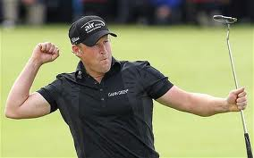 Jamie Donaldson punches the air in delight!
